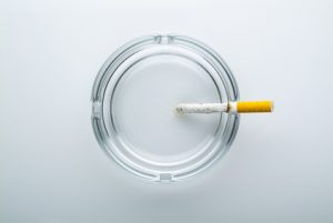 ash tray with cigarette